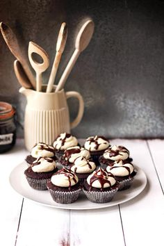coconut mocha cupcakes with coconut frosting and mocha drizzle