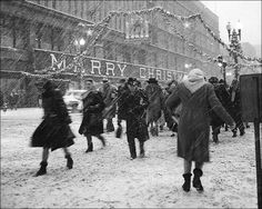 Macy's Christmas shopping in snow, NYC, ca. 1950s