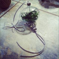 Xmas ornament using glass ball, foliage, repurposed jewelry and ribbon.