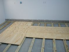 Dave's experience installing a plywood floor with 2x4 sleepers in his wood shop.