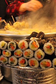 This is Kkoma Gimbap, or mini-gimbap. At the back is Odaeng, or fish cakes on skewers!