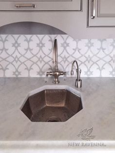Avila, a natural stone waterjet and hand cut mosaic shown in Thassos honed and Statuarietto polished, is part of the Miraflores Collection by Paul Schatz for New Ravenna Mosaics.<br /> -photo courtesy of Architectual Ceramics