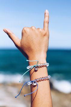 Limited Edition World Ocean's Day bracelets have arrived! Order yours today to get yours by World Ocean's Day Summer Bracelets, Cute Bracelets, Bangles, Pearl Cream, Ivory Pearl, Flapper Accessories, Jewelry Accessories, Recycled Bracelets, 4 Oceans