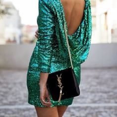 Look stunning this season in a sequined emerald green dress. | It's all about jewel tones for the Holidays.