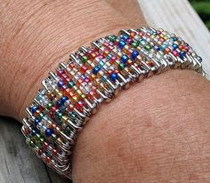 Bracelet made with safety pins, beads and elastic cord. Neat!