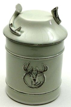 Ceramic Deer Goodie Jar with seal This Ceramic Deer Goodie Jar with seal will grace your kitchen or den decor.  Great jar for storing loose items or goodies. It has a deer profile on front and antler on lid.