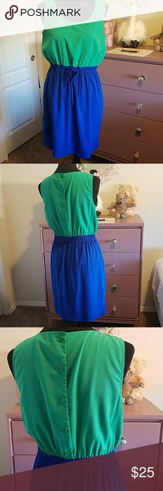 Calvin Klein colorblock dress Kelly green and cobalt blue colorblocking are bright and cheery, perfect for spring and summer! Light, silky fabric, cinched waist with tie, buttons on the back.  Excellent used condition! Calvin Klein Dresses