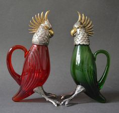Silver Red and Green Cut Glass Bird Jars. Learn about your collectibles, antiques, valuables, and vintage items from licensed appraisers, auctioneers, and experts at BlueVault. Visit:  http://www.BlueVaultSecure.com/roadshow-events.php
