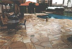 This natural sandstone crazy paving is an excellent non-slip product around the pool.