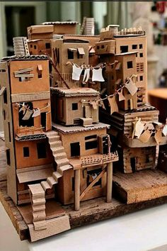 favela 3 // da trisbj - cardboard favela by pamela sullivan Cardboard City, Cardboard Sculpture, Cardboard Crafts, Paper Crafts, Cardboard Houses, Cardboard Mask, Cardboard Dollhouse, Cardboard Model, Cardboard Design