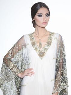 Caviar Bead Embellished Caftan Gown by Badgley Mischka. This beautiful caftan evening gown is elaborately detailed for a glamorous statement.