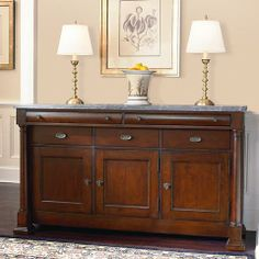 Louis-Philippe China Buffet With Marble Top in a Traditional Cherry finish at D Noblin Furniture...The Louis-Philippe collection reflects style embraced during the reign of this last true monarch of France. This buffet has 3 wood doors, 3 adjustable shelves, 1 felt-lined drawer, and 1 drawer with silver tray. The dark finish is reflective of the period.