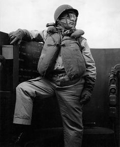 Captain Dixie Kiefer in a battle dress on the command bridge of USS Ticonderoga during the launching of aircraft against Luzon Philippines 6 November 1944.