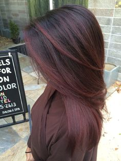 Red accents on dark hair #hairbysam #davidriossalon #darkred #colorist #georgetown #dc call and make an appointment with Samantha today! 202 525 2613