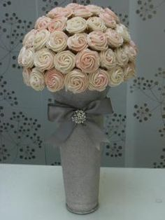This is an amazing arrangements of CUPCAKES--Special occasion mini rose bouquet  by TasteandSee in CT...wish I lived closer ( @Elizabeth Criscuolo !)