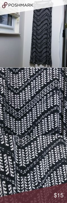 Chervon maxi skirt Funky black and white pattern printed on a stretchy, 95% rayon, 5% spandex skirt. Super comfy, slightly pilling but no other condition issues. Waistband is extra wide so I usually folded it down in half. Is sort of an off white. Living Doll Skirts Maxi