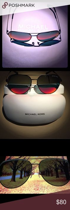 MK AVIATOR Gradient Colored lens Sunglasses Model:MK5009,Rodinara Size:58mm-13mm-135mm. MK AVIATOR style Sunglasses features it's frame with logo engraved detailing on the temples. The Michael Kors logo on left lens with a modern look and stylish design, this piece would make a great companion whether you're at the beach or out with friends. A must-have for your collection. All Michael Kors Sunglasses are scratch resistant lenses and simply look great!Includes: Michael Kors Hard storage…