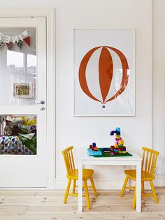 little corner for toddler with yellow chairs and ballon poster