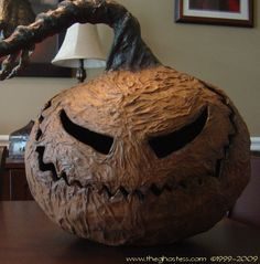 This is a really easy pumpkin head of watered down glue & the yellow pages!
