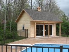 Pool House Shed with porch and sliding glass doors.