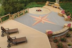 Wonderful Decking Design With Circle Detail Fire Pit And Star Focal Point