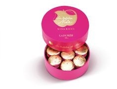 The Tentation de Nina Collection   The Nina macaron, an intense pink macaron topped with a leaf of gold filled with raspberry jam, flavoured with lemon and rose.