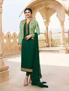 Prachi Desai Dark Green Color Georgette Satin Designer Suit with a Jacket. This suit is adorned with zari and thread embroidery and stone work. Comes with a matching dupatta. Fashion Online, Latest Fashion, Prachi Desai, Stone Work, Green Colors, Duster Coat, Kimono Top, Satin, India