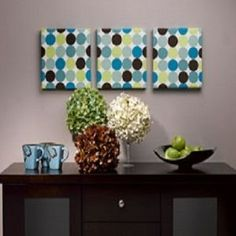 Cheap Decorating Ideas: wrap shoe box tops with cool fabric and hang