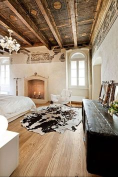 Exposed wooden beans, animal print rug