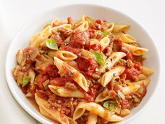 Penne with Turkey Ragu : Simmering the sauce with a Parmesan cheese rind allows the tomatoes to adopt that nutty, salty flavor.