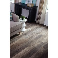 Shop STAINMASTER 10-Piece 5.74-in x 47.74-in Washed Oak Umber Floating Oak Luxury Commercial Vinyl Plank at Lowes.com  Like it but it may be too dark.