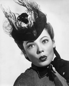 Gene Tierney.  Really not crazy about the whole bird being used on the hat - today this is called 'taxidermy fashion'.