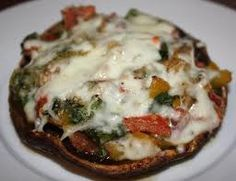 2 Portobello mushrooms   Balsamic vinegar   1 T olive oil   2 cloves garlic, minced   1/4 of an onion, chopped   1 yellow pepper, roasted and chopped   2 Roma tomatoes, chopped   2 cups of fresh spinach   1/4 cup breadcrumbs   Italian seasoning (I use a blend from Emeril)   Mozzerella cheese     1. Preheat the oven to 375 degrees. Remove the stem and gills from the mushroom. I use a spoon to scoop them out.   2. Brush the mushrooms with balsamic vinegar.   3. Heat olive oil in a small saute p...
