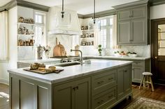 Barbara Westbrook talks about her philosophy for kitchen design in her book Gracious Homes. Your cabinetry should be very classic, then bring in warm and personality with accessories, lighting, and color.
