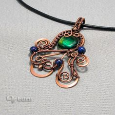 Hammered copper wire pendant with green dichroic glass by Artual