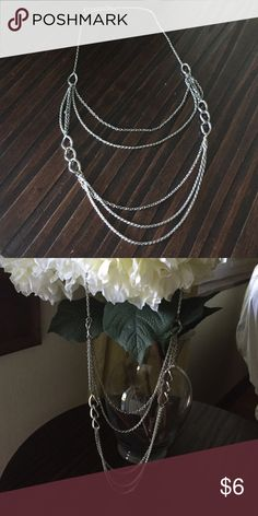 Silver tone layered chain necklace Silver tone layered long chain necklace. Clasp closure. Good, used condition. I'm not sure where I purchased this from but I think it may have been H&M. Questions? Please ask! Jewelry Necklaces