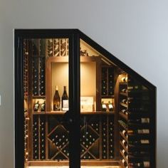 Custom built steel and glass door for this compact wine cellar that we artfully tucked away underneath the stairs. #winetime #wineoclock #winecellar #wine #custom
