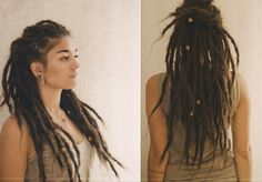 very long half-updo dreads with beads