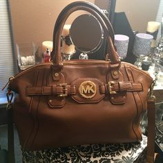 Authentic Michael Kors handbag * Free gift This gorgeous handbag is practically brand-new Its in real good used shape. I have more pictures of your interested. I paid almost $389 bran-new. It's a pretty large size. I used to carry my mini iPad in it. Offers appeared and trades are ok.  For anybody who buys more then 2 times from my closet I will throw in free Sport Waist Trainer retails at $65 .. You can comment below for more information. Michael Kors Bags Satchels