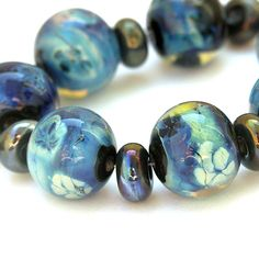 Ghost Flowers -  Handmade Lampwork Bead Set with Silver Glass in Blue and Green (7 beads, 8 spacers)