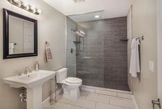 Contemporary 3/4 Bathroom with Kohler Tresham Pedistal Sink, Shower jets, Gris Foussana Limestone, Pedestal sink