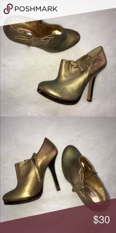 Report Signature Report Signature leather goldish booties. Size 8.5 in great condition. Report Signature Shoes Ankle Boots & Booties