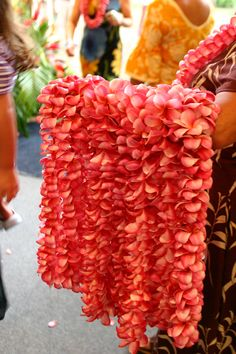 This beautiful lei is one of the many fresh flower leis you can purchase at your luau here in Hawaii. Travel to Maui providing quality vacations to Hawaii and beyond. photo credit to the Hawaii Visitor Bureau Hawaiian Flowers, Hawaiian Luau, Hawaiian Islands, Tropical Flowers, Exotic Flowers, Hawaii Tourism, Hawaii Travel, Aloha Hawaii, Hawaii Beach