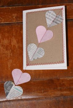 First Wedding Anniversary card 'paper', simple newspaper and handmade paper hearts sewn onto kraft card.