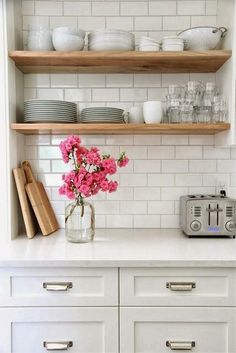 White kitchen cabinets, white worktop, white subway tiles and open wood shelves Kitchen Shelves, Diy Kitchen, Kitchen Dining, Kitchen Decor, Open Shelves, Kitchen White, Kitchen Ideas, Timber Shelves, Glass Shelves