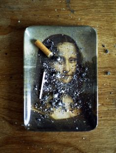 """This Mona Lisa ashtray photo is wrong on SO many levels! -- (Original source unknown; the oldest post I can find is on """"car parts, bottles and cutlery,"""" repinned from the defunct Tumblr account of """"bellagoth."""")"""