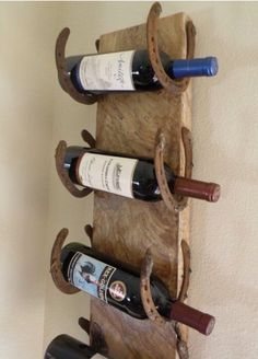 Old horseshoes, old barn wood ~ instant wine rack!