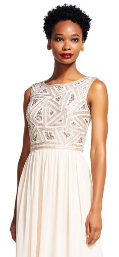 Geometric beading and soft chiffon pair up to create this feminine formal dress. This evening gown features a geometric beaded bodice with beading that lines the neckline and sleeveless bodice as well as accents the empire waist. The beaded design of this dress gives way to a flowing chiffon skirt. A v-back and zipper closure completes this party dress. Pair this chiffon beaded dress with metallic accessories for a winning style.