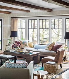 Great mix of color, texture and patterns.  Tom Filicia.  House Beautiful.    #livingroom