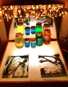 """Light table with coloured water & glitter to mark make in, shared by Fairy Dust Teaching ("""",)"""